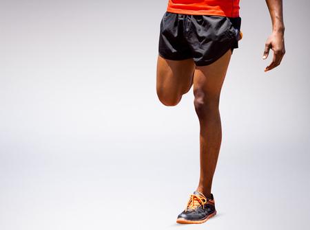 athleticism: Athletic man hopping against grey vignette
