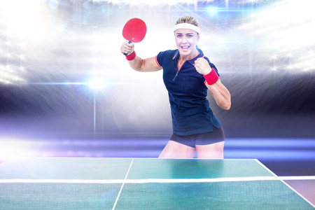 ping pong: Composite image of female athlete is winning a ping pong match in a stadium