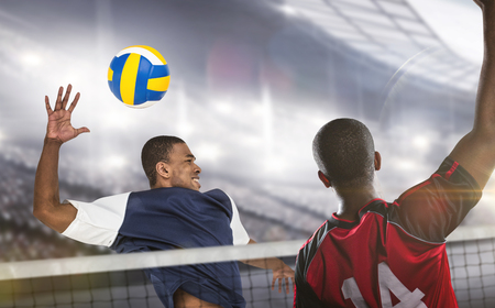 sportsmen: Composite image of sportsmen are playing volleyball in a stadium