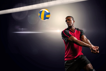 spot light: Composite image of sportsman playing volleyball against spot light