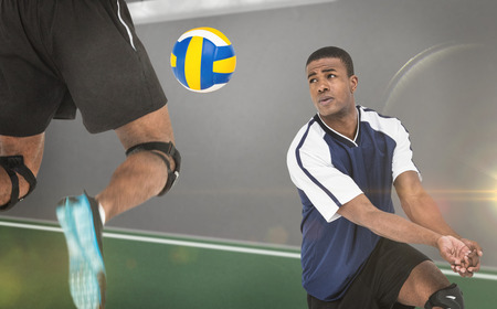 sportsmen: Composite image of sportsmen are playing volleyball in a sport field