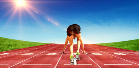 starting block: Composite image of sportsman in starting block on race track