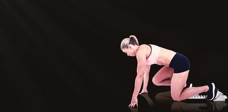start line: Composite image of female athlete on the start line against black background