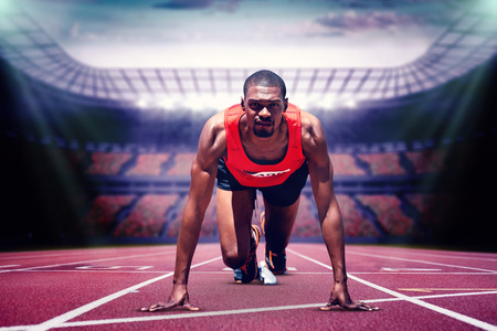 starting block: Composite image of athlete man in the starting block in a stadium Stock Photo