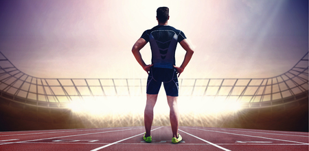 Composite image of athlete man posing with hands on hips in a stadium