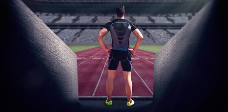 skintight: Composite image of athlete man posing with hands on hips in a stadium