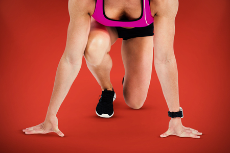 start line: Composite image of female athlete on the start line against red background