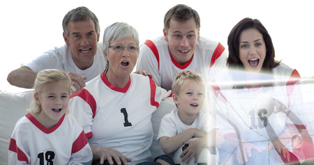 Composite image of excited family watching a football match in television at home photo