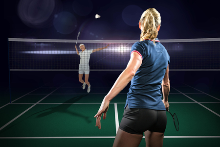 Composite image of badminton players playing badminton on badminton field