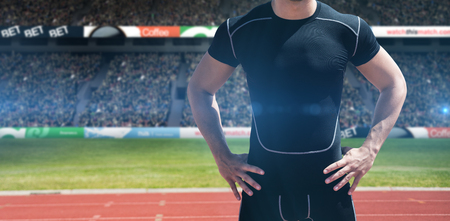 skintight: Portrait of athletic man chest against view of a stadium Stock Photo