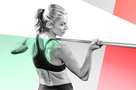 javelin: Athlete preparing to throw javelin against colored background