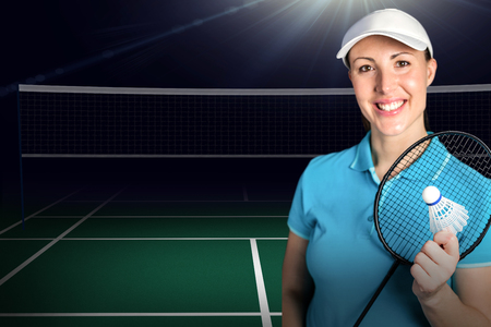 racket: Composite image of badminton player holding badminton racket and shuttlecock against badminton field Stock Photo