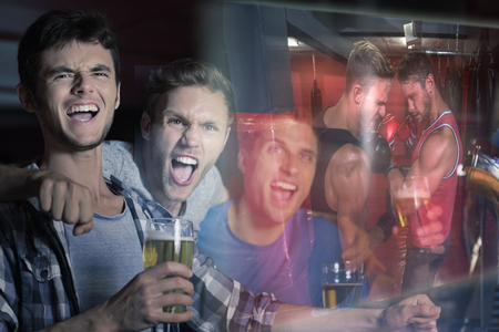 boxing match: Composite image of friends are watching boxing match in a pub Stock Photo