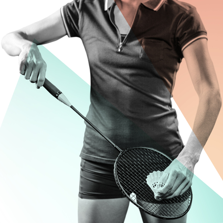 racquet: Badminton player holding a racquet ready to serve  against yellow and blue