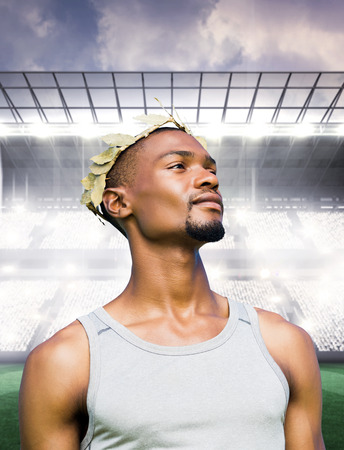 the victorious: Portrait of victorious sportsman  against sports arena Stock Photo
