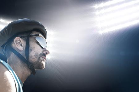 fourties: Composite image of man wearing a helmet against spotlight