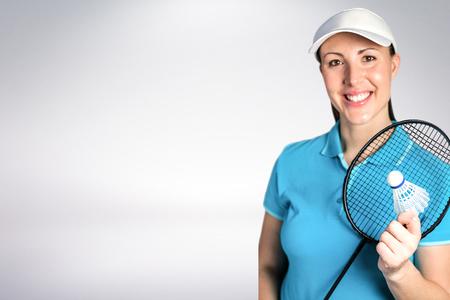 badminton racket: Composite image of badminton player holding badminton racket and shuttlecock against white background