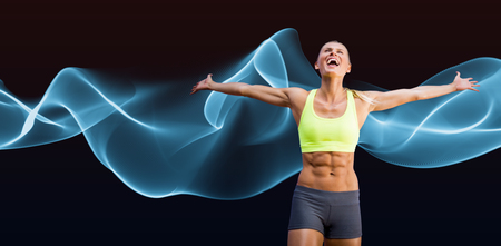 stretched: Fit woman celebrating victory with arms stretched against blue wave Stock Photo