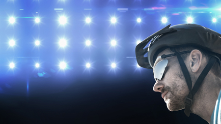 adventuring: Composite image of man wearing a helmet against spotlight