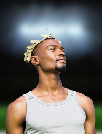 the victorious: Portrait of victorious sportsman  against football pitch under spotlights