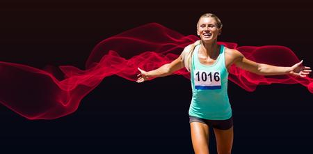 finishing: Sportswoman finishing her run against blue design Stock Photo