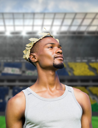 the victorious: Portrait of victorious sportsman  against large football stadium with brasilian fans