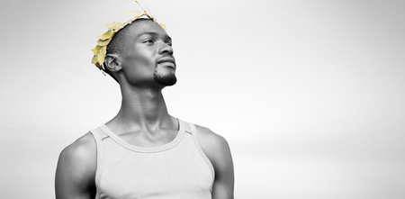 the victorious: Portrait of victorious sportsman with crown of laurels  against blue wave Stock Photo