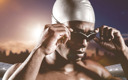 sky dive: Swimmer ready to dive against composite image of stadium with cloudy sky Stock Photo