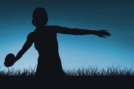 lanzamiento de disco: Concentrated sportswoman practising discus throw  against blue sky over grass Foto de archivo