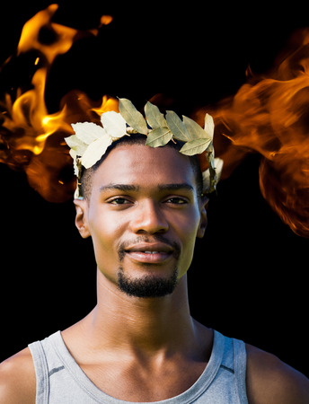 the victorious: Portrait of victorious sportsman with crown of laurels  against fire
