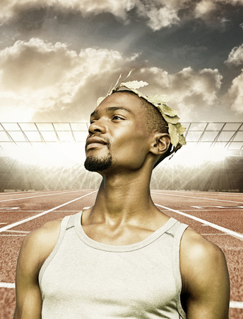 the victorious: Portrait of victorious sportsman  against race track