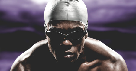 hombre deportista: Swimmer ready to dive against road leading out to the horizon at night