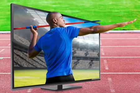 lanzamiento de jabalina: Profile view of sportsman practising javelin throw  against view of a stadium