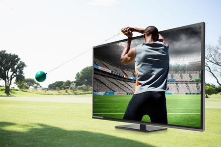 hammer throw: Rear view of sportsman practising hammer throw  against rugby stadium
