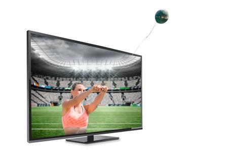 hammer throw: Portrait of sportswoman practising hammer throw  against rugby stadium