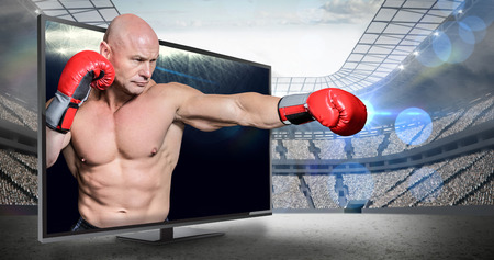 fighting stance: Bald boxer in fighting stance against view of spotlights