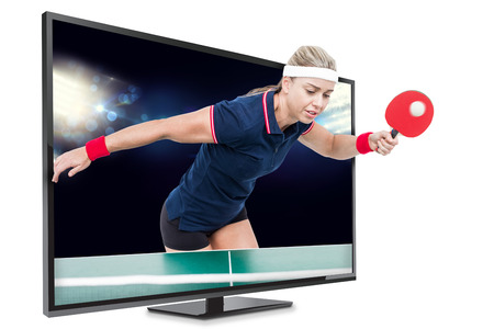 ping pong: Female athlete playing ping pong against view of spotlights