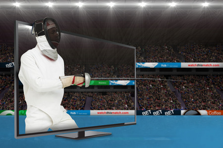 fencing sword: Man wearing fencing suit practicing with sword against view of a stadium Stock Photo