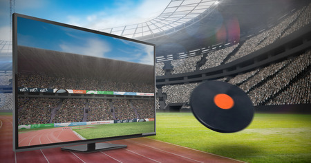 discus: View of a discus against view of a stadium Stock Photo