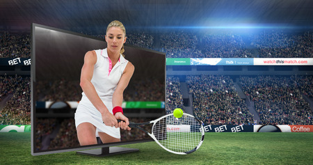 racket stadium: Athlete playing tennis with a racket  against view of a stadium Stock Photo