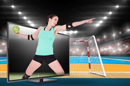 female elbow: Female athlete with elbow pad throwing handball against digital image of handball field indoor Stock Photo