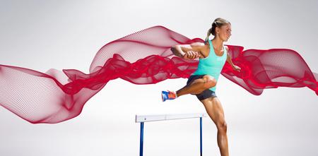hurdles: Sportswoman practising the hurdles against blue design Stock Photo
