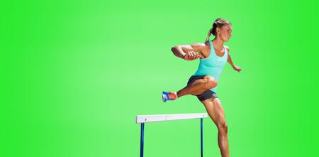 hurdles: Sportswoman practising the hurdles against green background