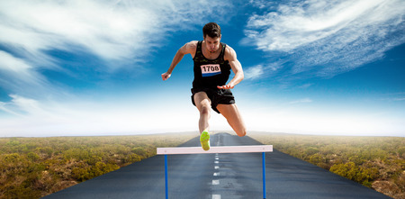 top animated: Sportsman practising hurdles against view of an empty street Stock Photo