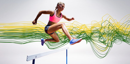hurdle: Sporty woman jumping a hurdle against blue design