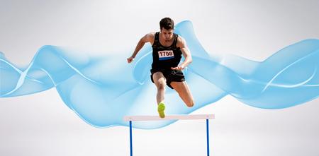 practising: Sportsman practising hurdles against blue wave