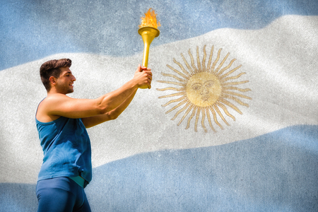 argentinian flag: Low angle view of sportsman holding a cup  against argentinian flag