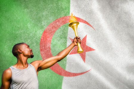 algerian flag: Front view of sportsman holding a cup  against algerian flag Stock Photo