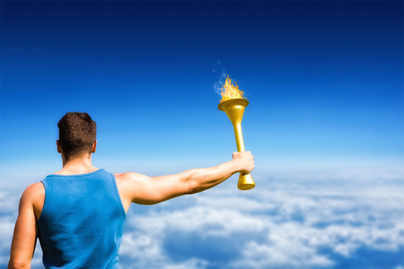 altitude: Rear view of sportsman holding a cup  against blue sky over clouds at high altitude Stock Photo