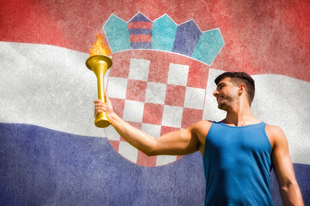 low prizes: Low angle view of sportsman holding a cup  against digitally generated croatia national flag